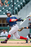 Bryce Brentz (25) of the Pawtucket Red Sox follows through on his swing against the Charlotte Knights at BB&T Ballpark on August 8, 2014 in Charlotte, North Carolina.  The Red Sox defeated the Knights  11-8.  (Brian Westerholt/Four Seam Images)
