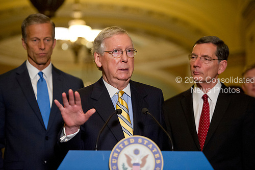 United States Senate Majority Leader Mitch McConnell (Republican of Kentucky) speaks to reporters following the Republican Party luncheon in the United States Capitol in Washington, DC on Tuesday, June 27, 2017.  From left to right: US Senator John Thune (Republican of South Dakota), Leader McConnell, and US Senator John Barrasso (Republican of Wyoming).<br /> Credit: Ron Sachs / CNP