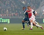 Nederland, Amsterdam, 20 januari 2013.Eredivisie.Seizoen 2012-2013.Ajax-Feyenoord.Viktor Fischer (r.) van Ajax en Tonny Vilhena (l.) van Feyenoord strijden om de bal.