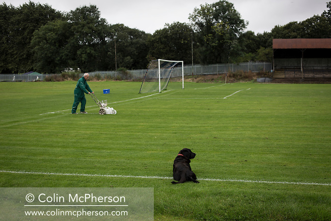 Committee member Angus Wallace marking the pitch at Millburn Park, Alexandria, before Vale of Leven hosted Ashfield in a West of Scotland League Central District Second Division Junior fixture. Vale of Leven were one of the founder members of the Scottish League in 1890 and remained part of the SFA and League structure until 1929 when the original club folded, only to be resurrected as a member of the Scottish Junior Football Association after World War II. They lost the match to Ashfield by 4-3, having led 3-1 with 10 minutes remaining.