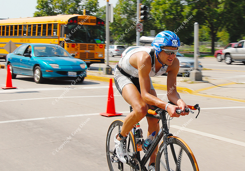 Ironman winner Maik Twelsiek finishes the second leg of the race minutes ahead of other bikers on Sunday, 9/9/07, during the second leg of the marathon