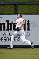 Fort Myers Miracle outfielder Travis Harrison (17) chases down a fly ball during a game against the St. Lucie Mets on April 18, 2014 at Hammond Stadium in Fort Myers, Florida.  St. Lucie defeated Fort Myers 15-9.  (Mike Janes/Four Seam Images)