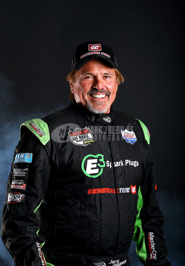 Mar. 21, 2014; Chandler, AZ, USA; LOORRS pro 4 driver Jerry Daugherty poses for a portrait prior to round one at Wild Horse Motorsports Park. Mandatory Credit: Mark J. Rebilas-USA TODAY Sports