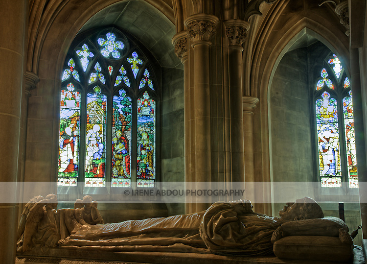 The crypt of former US President Woodrow Wilson lies in Bethlehem Chapel, on the lower level of Washington, DC's Washington National Cathedral.  This high dynamic range (HDR) image allows the image to capture detail in both the sculpture and interior architecture, as well as the stained glass windows.