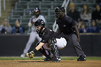 Kannapolis Intimidators catcher Gunnar Troutwine (37) reaches for a low pitch as home plate umpire James Jean looks on during the game against the Rome Braves at Kannapolis Intimidators Stadium on April 4, 2019 in Kannapolis, North Carolina.  The Braves defeated the Intimidators 9-1. (Brian Westerholt/Four Seam Images)
