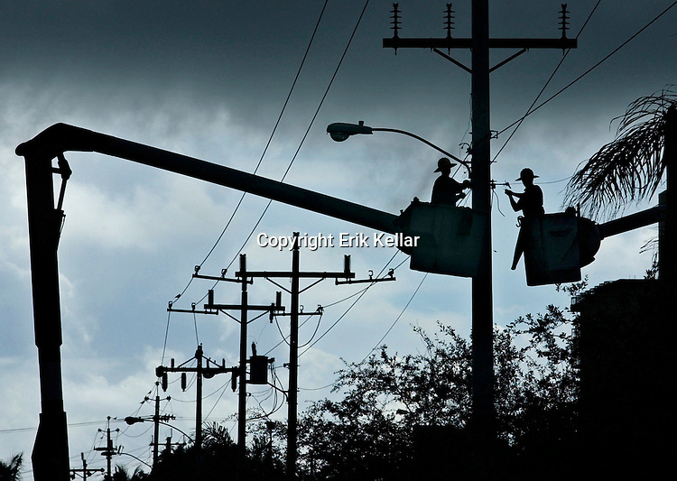 .Robert Bliss, left, and Jeff Tomlinson, both linemen from Kohler Electric Construction in St. Petersburg, string new power lines to handle the doubled capacity for the growth of the power substation on South Marco Island on Friday. Until about the second week of September, the construction company will be replacing all the existing power poles and lines on San Marco Road, after which, they will move on to areas on the south side of the island..Erik Kellar/Staff 09/07/2001