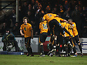 Adam Marriott of Cambridge United is mobbed by team-mates after scoring from a free-kick during the Blue Square Bet Premier match between Cambridge United and Kidderminster Harriers at the Abbey Stadium, Cambridge on 18th February, 2011 .© Kevin Coleman 2011.