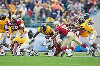 January 01, 2010:   West Virginia running back Noel Devine (7) rushes for yardage during Konica Minolta Gator Bowl College football action between the West Virginia Mountaineers and the Florida State Seminoles played at the Jacksonville Municipal Stadium in Jacksonville, Florida on January 01, 2010.  Florida State defeated West Virginia 33-21.
