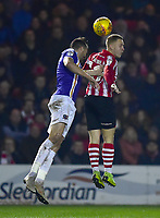 Lincoln City's Danny Rowe vies for possession with Exeter City's Aaron Martin<br /> <br /> Photographer Andrew Vaughan/CameraSport<br /> <br /> The EFL Sky Bet League Two - Lincoln City v Exeter City - Tuesday 26th February 2019 - Sincil Bank - Lincoln<br /> <br /> World Copyright © 2019 CameraSport. All rights reserved. 43 Linden Ave. Countesthorpe. Leicester. England. LE8 5PG - Tel: +44 (0) 116 277 4147 - admin@camerasport.com - www.camerasport.com