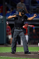Umpire Cliburn Rondon strike three call during a NY-Penn League game between the West Virginia Black Bears and Auburn Doubledays on August 23, 2019 at Falcon Park in Auburn, New York.  West Virginia defeated Auburn 6-5, the second game of a doubleheader.  (Mike Janes/Four Seam Images)
