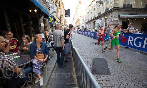 24 AUG 2013 - STOCKHOLM, SWE - Aileen Reid (IRL) (right) of Ireland runs through the cobbled streets of Gamla Stan the old part of Stockholm, Sweden during the elite women's ITU 2013 World Triathlon Series round (PHOTO COPYRIGHT © 2013 NIGEL FARROW, ALL RIGHTS RESERVED)