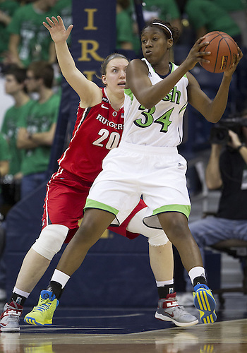 January 13, 2013:  Notre Dame forward Markisha Wright (34) catches the ball as Rutgers forward Christa Evans (20) defends during NCAA Basketball game action between the Notre Dame Fighting Irish and the Rutgers Scarlett Knights at Purcell Pavilion at the Joyce Center in South Bend, Indiana.  Notre Dame defeated Rutgers 71-46.
