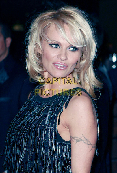 PAMELA ANDERSON.Paris Hilton and Nicky Hilton host LAX Nightclub's New Year's Eve Bash held at the LUXOR Hotel and Casino Las Vegas, Las Vegas, Nevada, USA, 31 December, 2007..portrait headshot black fringed dress tassels barb wire tattoo.CAP/ADM/MJT.©MJT/AdMedia/Capital Pictures.