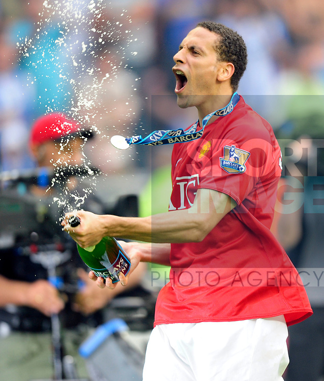 Rio Ferdinand celebrates winning the Premier League trophy by spraying champagne during the Premier League match at The JJB Stadium, Wigan. Picture date 11th May 2008. Picture credit should read: Simon Bellis/Sportimage