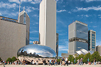 Clouds decorate the summer sky over Cloud Gate in Millennium Park, Chicago, Illinois