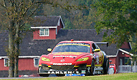The #49 Mazda od Memo Gidley, Joe Nonnamaker, Wayne Nonnamaker, WIll Nonnamaker and Joe Sahlen races past a red building during the Grand-Am Rolex Series test at Virginia International Raceway, Alton, VA , October 2010. (Photo by Brian Cleary/www.bcpix.com)