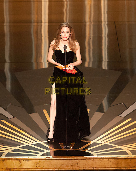 Angelina Jolie presents at the 84th Annual Academy Awards® from the Hollywood and Highland Center, in Hollywood, CA, Sunday, February 26, 2012..*Editorial Use Only*.oscars full length stage black strapless dress slit split leg thigh   .CAP/A.M.P.A.S./NFS.©A.M.P.A.S. Supplied by Capital Pictures.