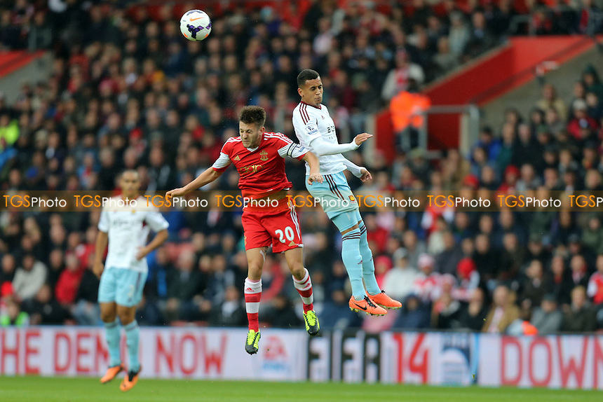 Ravel Morrison of West Ham and Adam Lallana of Southampton - Southampton vs West Ham United, Barclays Premier League at St Mary's Stadium, Southampton - 15/09/13 - MANDATORY CREDIT: Rob Newell/TGSPHOTO - Self billing applies where appropriate - 0845 094 6026 - contact@tgsphoto.co.uk - NO UNPAID USE
