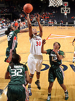 Jan. 6, 2011; Charlottesville, VA, USA; Virginia Cavaliers forward Telia McCall (30) shoots between Miami Hurricanes forward Morgan Stroman (32), Miami Hurricanes guard Shenise Johnson (42) and Miami Hurricanes guard Krystal Saunders (12) during the game at the John Paul Jones Arena. Miami won 82-73. Mandatory Credit: Andrew Shurtleff-