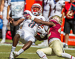 Florida State defensive back Lamarcus Brutus, right, sacks Louisville quarterback Lamar Jackson in the first half of an NCAA college football game against Louisville in Tallahassee, Fla., Saturday, Oct. 17, 2015. (AP Photo/Mark Wallheiser)