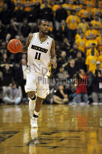 Jan 23, 2010; Columbia, MO, USA; Missouri Tigers guard Zaire Taylor (11) drives downcourt in the second half of the game against the Nebraska Cornhuskers at Mizzou Arena in Columbia, MO. Missouri won 70-53. Mandatory Credit: Denny Medley-US PRESSWIRE
