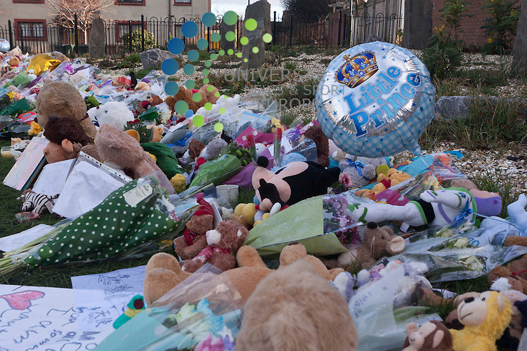 Members of the public lay flowers and candles in Ferry Gait Crescent:<br /> The mother of three-year-old Mikaeel Kular has been jailed for 11 years after she admitted killing her son and hiding his body in a suitcase.<br /> Mikaeel died two days after being beaten by Rosdeep Adekoya, 34, at the family's flat in Edinburgh in January.<br /> She put his body in a suitcase before dumping it behind her sister's house 20 miles away in Kirkcaldy, Fife.<br /> Adekoya originally told police that Mikaeel had disappeared from her home, leading to a major two-day search.<br /> She had been charged with murder, but admitted the reduced charge of culpable homicide.<br /> Picture: Universal News And Sport (Scotland) 25 August  2014.