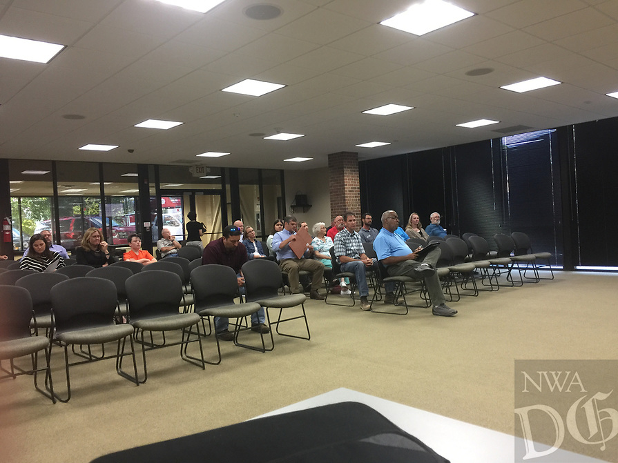 NWA DEMOCRAT-GAZETTE/TRACY M. NEAL Several people attended the Rogers City Council meeting on Tuesday, July 11, 2017.