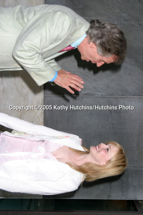 Henry Winkler.Kathryn Morris.He was telling her how much he loved her work.CBS TCA Summer Press Tour Party.(TCA = Television Critics Association).Los Angeles, CA.July 19, 2005.©2005 Kathy Hutchins / Hutchins Photo