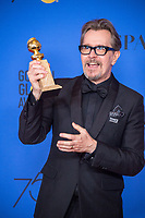 After winning the category of BEST PERFORMANCE BY AN ACTOR IN A MOTION PICTURE &ndash; DRAMA for his role in &quot;Darkest Hour,&quot; actor Gary Oldman poses backstage in the press room with his Golden Globe Award at the 75th Annual Golden Globe Awards at the Beverly Hilton in Beverly Hills, CA on Sunday, January 7, 2018.<br /> *Editorial Use Only*<br /> CAP/PLF/HFPA<br /> &copy;HFPA/PLF/Capital Pictures