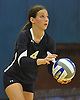 Plainview JFK No. 4 Jamie Yonker gets ready to serve during a Nassau County varsity girls' volleyball match against host Massapequa High School on Wednesday, September 9, 2015. Massapequa won 25-21, 25-14, 25-16.<br /> <br /> James Escher
