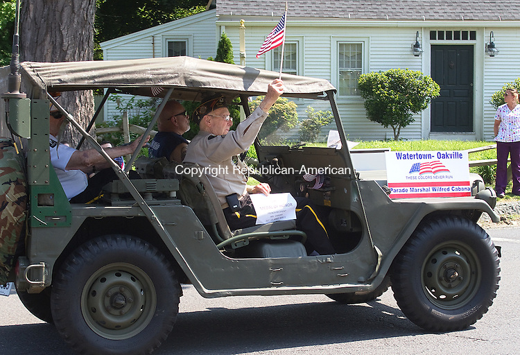 WATERTOWN, CT.- 28 MAY 2012  052812JW05 - WWII Veteran and Parade Marshall Wilfred Cabana waves a flag as he is driven in  the Watertown Memorial Day Parade Monday morning.  Jonathan Wilcox Republican American