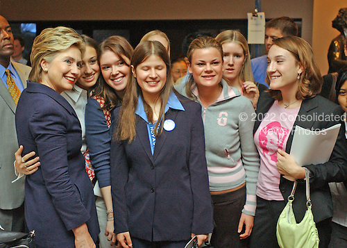 "Washington, D.C. - September 21, 2004 -- United States Senator Hillary Rodham Clinton (Democrat of New York), left, poses with a group of students after speaking at the Center for American Progress seminar titled ""Transforming the Reserve Component for the 21st Century"" at Georgetown University in Washington, D.C. on September 21, 2001.  In her remarks, Senator Clinton criticized the Bush Administration for a lack of resources for the National Guard, even in the face of their expanded role in national security and homeland security efforts..Credit: Ron Sachs / CNP.(RESTRICTION: NO New York or New Jersey Newspapers or newspapers within a 75 mile radius of New York City)"