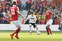 Daniel James of Swansea City (C) and Molla Wague of Nottingham Forest (R) in action during the Sky Bet Championship match between Nottingham Forest and Swansea City at City Ground, Nottingham, England, UK. Saturday 30 March 2019
