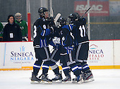 Brockport Blue Devils Wyatt Johnson (8), Koby Dusett (6), Carlton Eklyor (11) and Kirby Trask (15 - hidden) celebrate a goal during a varsity ice hockey game against the Notre Dame Fighting Irish of Batavia during the Section V Rivalry portion of the Frozen Frontier outdoor hockey event at Frontier Field on December 22, 2013 in Rochester, New York.  (Copyright Mike Janes Photography)