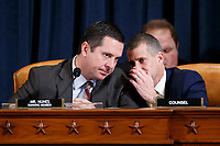 Ranking member of the House Permanent Select Committee on Intelligence Devin Nunes (L) talks with minority legal counsel Steve Castor (R) during the House Permanent Select Committee on Intelligence public hearing on the impeachment inquiry into US President Donald J. Trump, on Capitol Hill in Washington, DC, USA, 19 November 2019. The impeachment inquiry is being led by three congressional committees and was launched following a whistleblower's complaint that alleges US President Donald J. Trump requested help from the President of Ukraine to investigate a political rival, Joe Biden and his son Hunter Biden.<br /> Credit: Shawn Thew / Pool via CNP/AdMedia