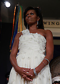 Washington, DC - January 20, 2009 -- First Lady Michelle Obama stands by as her husband speaks on stage during MTV & ServiceNation: Live From The Youth Inaugural Ball at the Hilton Washington on January 20, 2009 in Washington, DC. President Barack Obama was sworn in as the 44th President of the United States today, becoming the first African-American to be elected President of the US.  .Credit: Mark Wilson - Pool via CNP