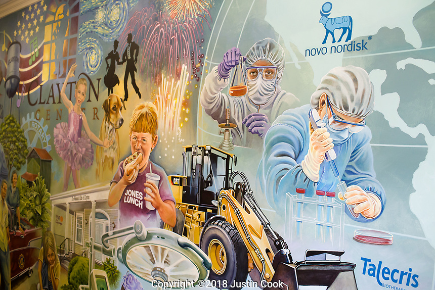 The history of Clayton, NC is depicted on a mural at the public library, from it's farming roots, to pharmacy future with the Novo Nordisk plant. Friday, April 27, 2018. (Justin Cook for STAT News)