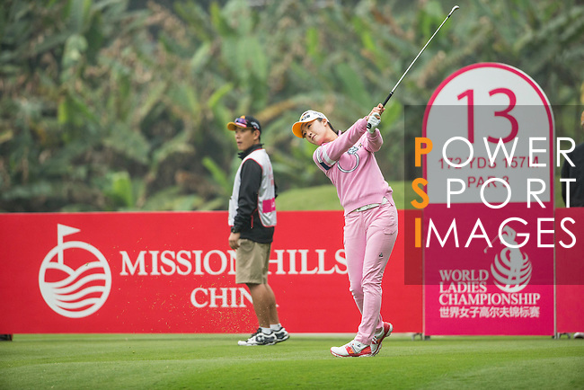 Ji Hyun Oh of South Korea tees off at the 13th hole during Round 3 of the World Ladies Championship 2016 on 12 March 2016 at Mission Hills Olazabal Golf Course in Dongguan, China. Photo by Victor Fraile / Power Sport Images