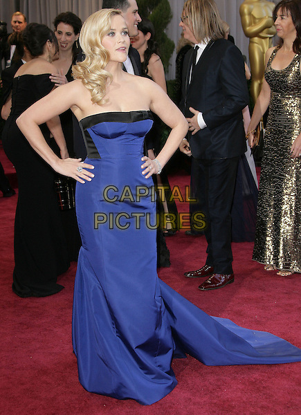 Reese Witherspoon (wearing Louis Vuitton).85th Annual Academy Awards held at the Dolby Theatre at Hollywood & Highland Center, Hollywood, California, USA..February 24th, 2013.oscars full length dress hands on hips black strapless cobalt blue train .CAP/ADM.©AdMedia/Capital Pictures.
