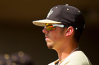 Charlie Morgan #26 of the Wake Forest Demon Deacons watches the game against the North Carolina State Wolfpack from the dugout at Doak Field at Dail Park on March 17, 2012 in Raleigh, North Carolina.  The Wolfpack defeated the Demon Deacons 6-2.  (Brian Westerholt/Four Seam Images)
