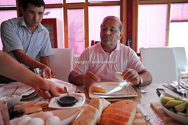 Household help bring breakfast, including caviar, for Ibrahim Ibrahimov, an Azerbaijani oligarch and billionaire, in one of several houses on his Caspian seaside property he used to inhabit with his family in the Garadagh region just southwest of Baku, Azerbaijan on July 18, 2012.  Ibrahimov is the developer behind the Khazar Islands artificial islands project; in his private life, he enjoys building a home for his family, moving in, and then quickly tires of the property before building a new home on an adjacent lot on his seaside lands.