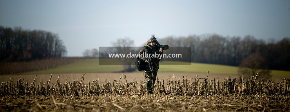 A member of the French Foreign Legion moves to his assigned position after jumping over a plain north of Tarbes, France, during a full scale multi-force exercise, 12 December 2007.