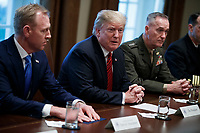 US President Donald J. Trump attends a briefing by senior military leaders