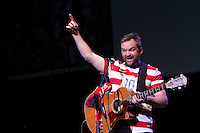 Brad Corrigan performs at the Paramount Theater in Denver, CO before the USA Men's National Team prep rally on March 21, 2013.