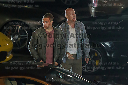 Australian actor Jai Courtney (L) and US actor Bruce Willis (R) participate a rehearsal of a fight schene on set during a shooting of their next movie fifth in the Die Hard series titled Good Day to Die Hard in Budapest, Hungary on July 11, 2012. ATTILA VOLGYI