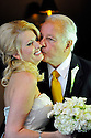 Former Governor Edwin Edwards, right,  kisses his new bride, Trina Grimes Scott, after a ceremony in the French Quarter in New Orleans, La., Friday, July 29, 2011. Edwards was recently released from prison where he served eight years on corruption charges....(AP Photo/Cheryl Gerber)