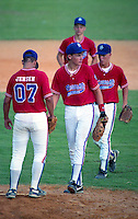First baseman Doug Blosser (center) playing for the Sarasota All-Stars during the 1992 season.  Blosser was drafted in the third round of the 1995 MLB Draft, he was killed in a car accident in January of 1998 after playing for the Spokane Indians and Lansing Lugnuts in 1997.  (MJA/Four Seam Images)