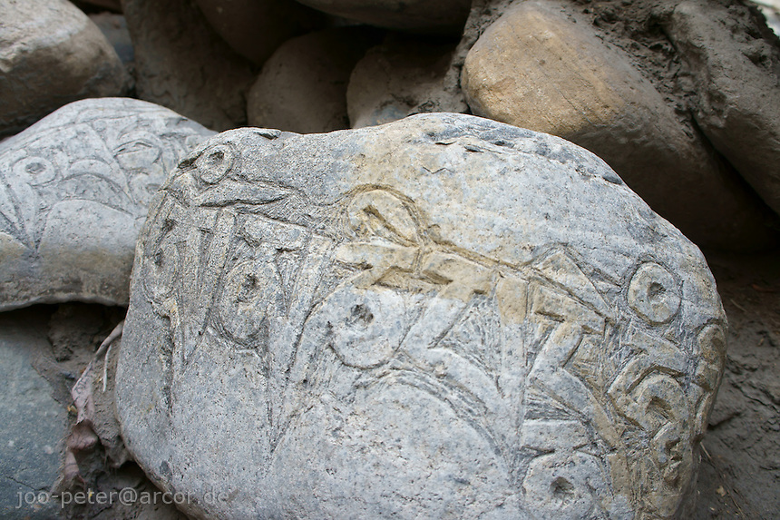 Stone with holy sanskrit inscription in Muktinath area, Himalaya, Nepal.October 2011. Muktinath is a major Hindu pilgrimage destination high up in the Himalaya mountains of Nepal