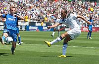 Chris Leitch (left) blocks the shot of Andros Townsend (right). San Jose Earthquakes vs Tottenham Hotspur at Buck Shaw Stadium in Santa Clara, California on July 17th, 2010.