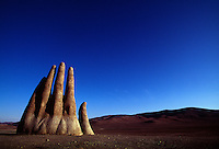 Fingers of a giant sculpted hand reach out of the relentless Atacama sands along the Pan American highway. The Mano de Desierto is a large-scale sculpture of a hand.  The art was funded by a local booster organization called Corporación Pro Antofagasta and inaugurated on March 28, 1992.<br /> Constructed by the Chilean sculptor Mario Irarrázabal, it has a base of iron and cement, and stands 11 meters tall. Besides sculptures and art, the desolate region south of Antofagasta, has geologic wonders of geysers and hot springs, volcanoes and saline lakes where flamingos breed.